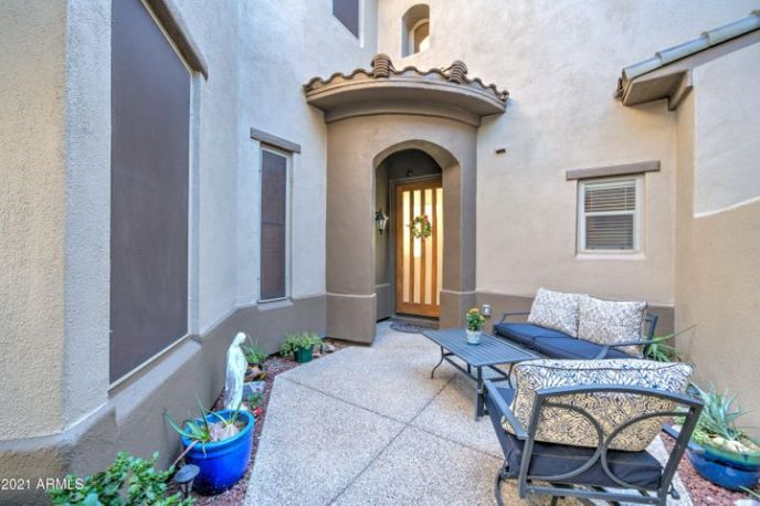 Wrought iron gated entry with nice sitting area.