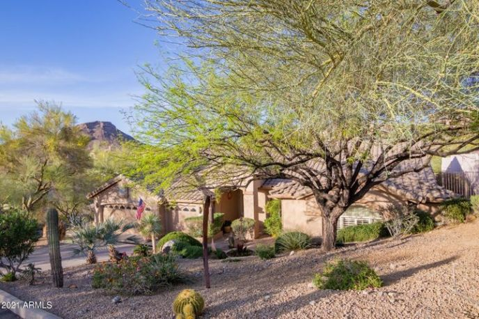 Nestled on .4 acre lot and backing to natural desert preserve. With views of Lookout Mountain!