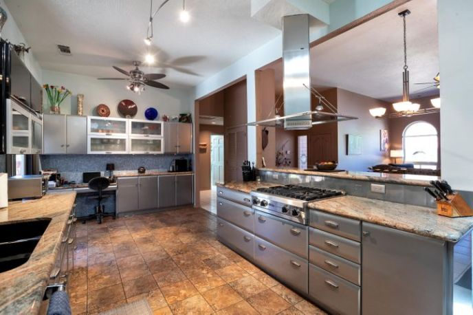 VIKING gas cooking, plenty of storage, stainless appliances, and metal cabinetry