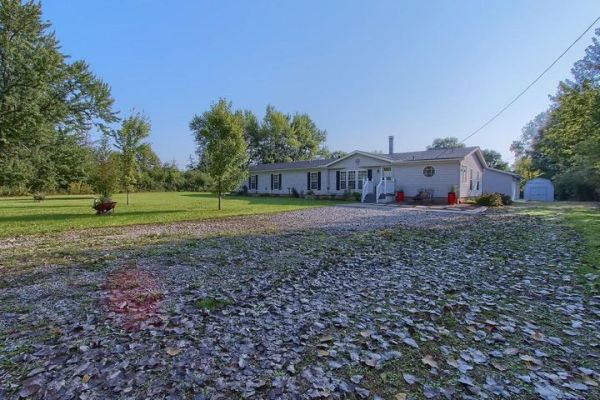 This manufactured home sits on 1.34 acres and is over 1900 sq ft.