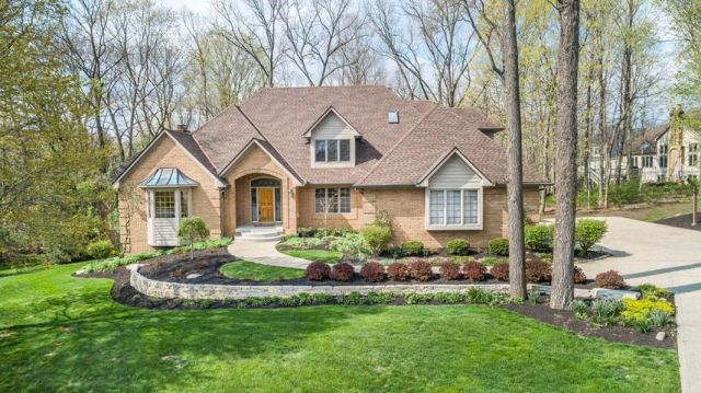 Beautiful custom all brick home on wooded cul de sac 3/4 acre lot with steam