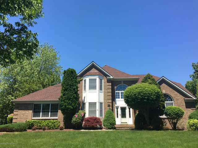 STATELY BRICK-FRONT COLONIAL
