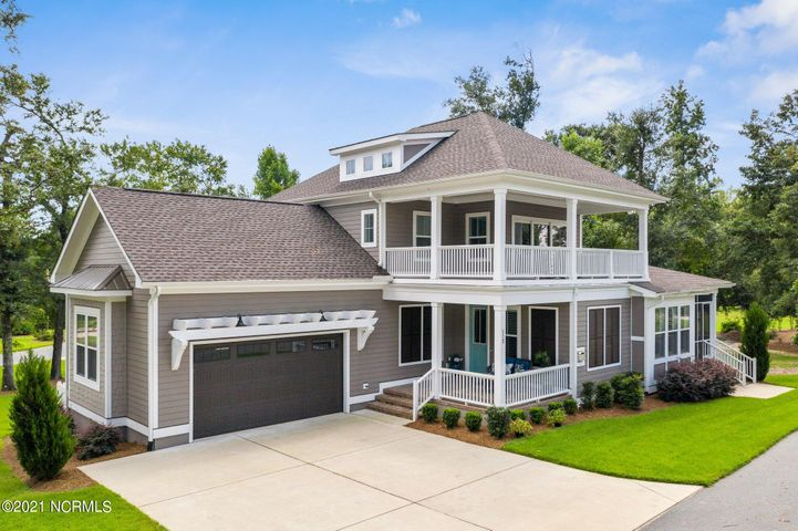 Custom built in 2018 4 bedroom/4 full bathroom with river view in highly sought after River Bluffs