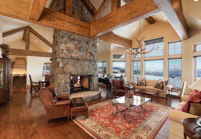 Stunning, unrestricted mountain vistas abound from this beautiful custom estate located on the 18th Fairway of Cordillera's Summit Golf Course. Surrounded by wildflowers, this home features a wonderful stone deck for dining alfresco, fireplaces throughout, a lower level recreation room and an inviting kitchen.