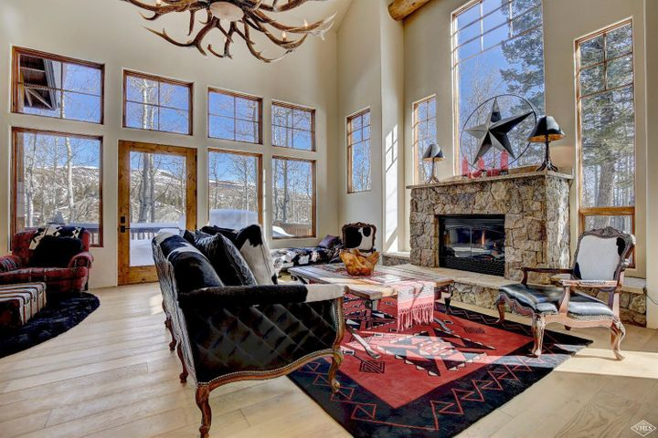 There is privacy & quiet on this wonderful treed site at the end of a cul-de-sac in the Lower Summit. The property has the true Colorado feel, starting with the gorgeous site & moving into the home itself. Huge windows surround the interior; enormous log beams lend just the right mountain feel; the dining room feels like a tree house, & the large kitchen & butler pantry will please the resident chef. Huge master suite. New wood floors will be installed in January. Furnishings negotiable.