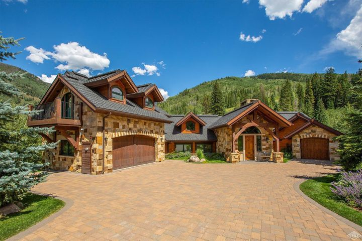 Lindsey Vonn's Mountain Home located on Black Gore Creek offering amazing mountain views. This residence offers 5 bedrooms 6.5 baths and elevator plus state of the art fitness room that could be the 6th bedroom. The great room features a large double sided stone fireplace,floor to ceiling windows with large kitchen,dining area and large deck for entertaining. The large family room downstairs has wet bar and fireplace. This is a very private home that you do not want to miss!