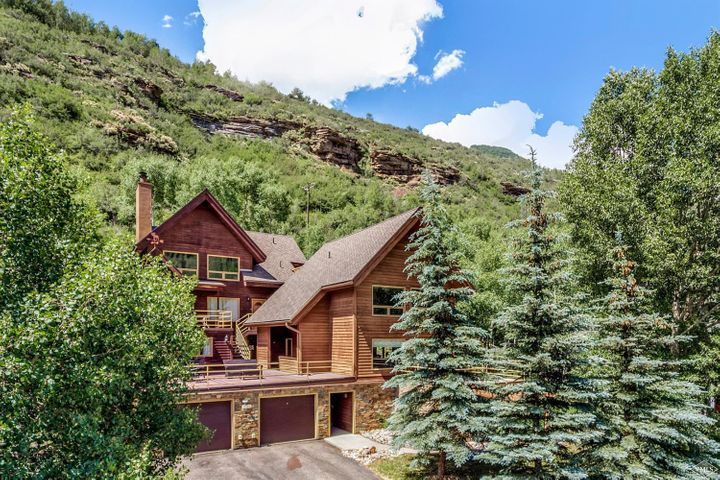Extensively remodeled 3-bedroom/2.5-bath half-duplex with a 1-car garage. Expansive surrounding mountain views of Gore Range, waterfalls and Vail Mountain. South-facing sunny exposure. With convenient access to Vail Village via the bike path, you are also just a short stroll away from The Vail Mountain School, Booth Creek Park, Town of Vail free bus stop, and only five minutes from world-class skiing and Vail Village. With National Forest just out your front door there are endless hiking trails.