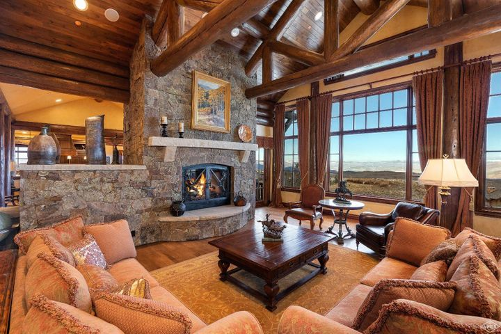 Custom built 6-bedroom, 9-bath home with log accents. Perched at the Summit of Cordillera, enjoy breath-taking views of Castle Peak and the Sawatch Range from the wrap around decks and outdoor Flagstone patios. Custom trim and details throughout home, with lots of thoughtful extras including library, wine cellar, billiard room with full bar, elevator, office and over-sized 3-car garage with over 1,200 +/-sqft of heated space. A truly one of a kind home.; Over 3 Car Garage