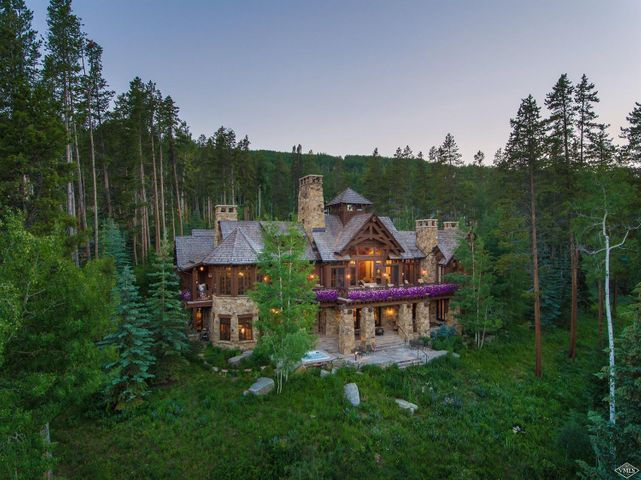 Attention to detail, quality and craftsmanship are a true reflection of this extraordinary home. Spectacular views of the Gore Range. Direct ski access in and out to Beaver Ski area via Strawberry Park. The expansive kitchen is like no other with a walk-in refrigerator, butlers pantry and inviting morning room. Heated flagstone deck and patio with surround sound. Formal and informal dining and living rooms offer plenty of places to gather and enjoy family and friends.