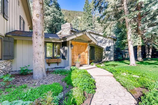 A breathtaking family home in East Vail with southern exposure, lots of sun, a smattering of tall pines, and a backyard view of Gore Creek.  Enjoy the advantage of having a backyard by the creek and away from the busy noise of Vail Village. East Vail is the most natural of all Vail neighborhoods.   Hiking the Big Horn trail and Gore Creek Trails are within walking distance.   Great access to the bike path, very little car traffic.  This streamside residence has a very warm and comfortable living area, 5 bedrooms, and 4.5 bath.   This is the nicest home site in East Vail.