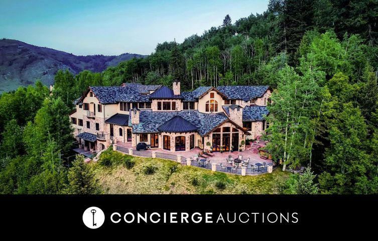 AUCTION: Previously Offered for $5.95M. No Reserve. Open Daily By Appointment. Nestled on 1.6 acres of coveted Colorado countryside, this 6-bedroom estate with a 1-bedroom guest house is the epitome of opulent living. With 3 stories, vaulted ceilings, and luxe details around every turn, 559 Eagle Drive thoughtfully integrates high-end finishes with magnificent mountain accents to create a truly one-of-a-kind estate. With multiple living areas, spacious patios, and ultra-comfortable home theater, this escape is an entertainment haven. After a day of hiking or skiing, enjoy peace in front of the fireplace or a long soak in a spacious tub while your guests find their own solace in the second Master or one of a selection of beautiful ensuite guest rooms. After partaking in the amenities at EagleVail Golf Club or a day on the famous slopes, grab a drink from your extensive wet bar, catch a film in your home theater, relax in your quiet library, or just enjoy the views from the patio with a glass of wine from your cellar. However you spend your days, the 12,420-square-foot estate at 559 Eagle Drive is the key to a life of luxury.