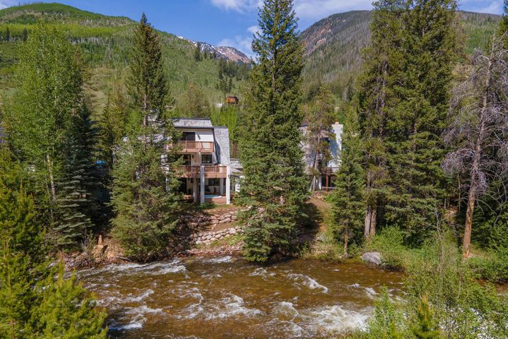 This home is so charming and is situated on what is truly the best location on Gore Creek in East Vail (and maybe all of Vail).  The setting is private and serene and allows you to soak up the natural beauty of Gore Creek and the Colorado mountains. This classic East Vail residence has a wood burning fireplace, a large deck overlooking the river, a remodeled kitchen and large windows that draw in natural light. The private master suite is on it's own level with a private deck and air conditioning.  Enjoy unobstructed views of the White River National Forest and the sights and sounds of the creek from any room in the home. A short walk to the Town of Vail bus will get you to the slopes and Vail Village in minutes and come home to soak in your private hot tub on the creek. It is incredible to find this quality a location, with heated driveways and a 2-car garage for 2 million dollars in Vail.  Oh life is so good when you own a home like this. But get ready to embrace remote working long-term as you won't ever want to leave.  Go to mls.gorecreekvail.com for more details.