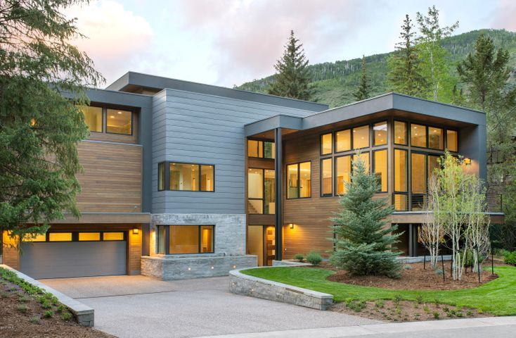 Beautiful, contemporary new construction on the Vail Golf Course. Enjoy the tranquil views from the floor to ceiling windows in the Living Room, as well as the terrace off the kitchen with a recessed hot tub. Wolf & Subzero package, radiant in-floor heating, zoned AC, snowmelt driveway. Enjoy the short walk to Vail Village or catch a ride on the Golf Course Bus Route for easy access. Secondary side of the duplex, with the Primary (1012 Eagles Nest Circle) being listed in the coming weeks.