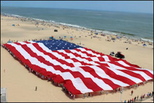 Image result for american flag on the beach images
