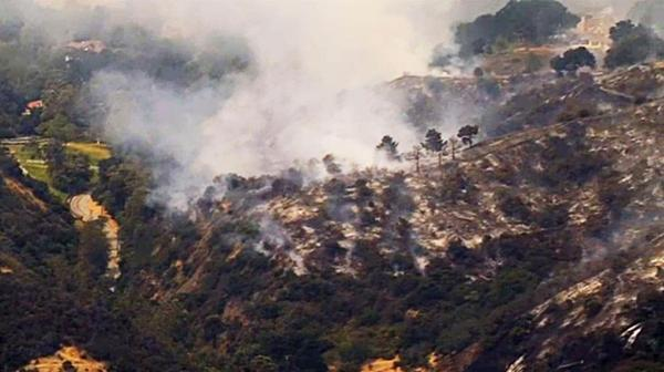 Brush fire on Los Angeles hillside sparked by weed whacker ...