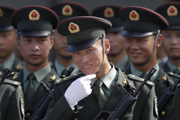 China flexes military muscle in Hong Kong during Xi's ...