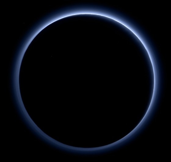 New Horizons looks toward the night side of Pluto and sees sunlight scattering through the periphery of the dwarf planet's atmosphere and forming a ring of blue color. This image was generated by software that combines information from blue, red and near-infrared images to replicate the color a human eye would perceive as closely as possible. Image credit: NASA / Johns Hopkins University Applied Physics Laboratory / Southwest Research Institute.