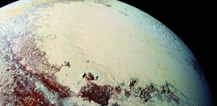 This Pluto mosaic was made from New Horizons LORRI images taken on July 14, 2015, from a distance of 49,700 miles (80,000 km). This view is projected from a point 1,118 miles (1,800 km) above Pluto's equator, looking northeast over the dark, cratered Cthulhu Regio toward the bright, smooth expanse of icy plains called Sputnik Planum. Pluto's North Pole is off the image to the left. This mosaic was produced with panchromatic images from the New Horizons LORRI camera, with color overlaid from the Ralph color mapper onboard New Horizons. Image credit: S.A. Stern et al.