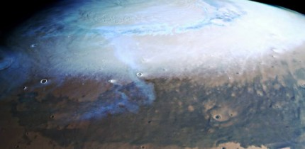 This image from ESA's Mars Express shows a beautiful slice of the Red Planet from the northern polar cap downwards, and highlights cratered, pockmarked swathes of the Terra Sabaea and Arabia Terra regions. It comprises data gathered on June 17, 2019. This image was created using data from the nadir and color channels of Mars Express' High Resolution Stereo Camera. The nadir channel is aligned perpendicular to the surface of Mars, as if looking straight down at the surface. North is up. Image credit: ESA / DLR / FU Berlin.