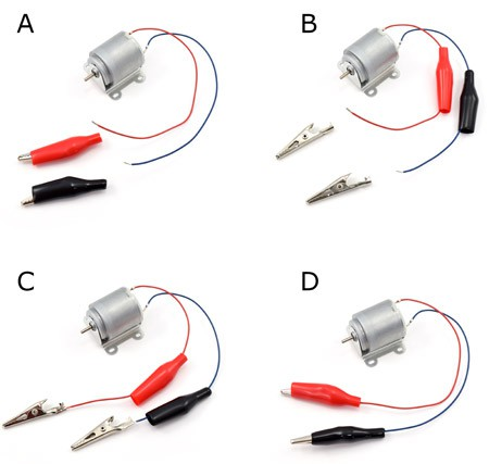 Alligator clips are attached to the ends of wires from a motor