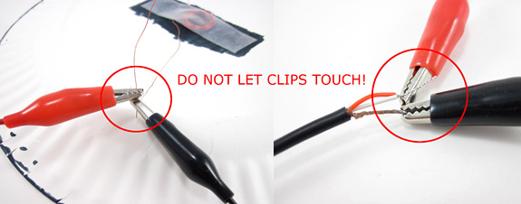 Photo shows two sets of alligator clips setup incorrectly with the leads touching each other