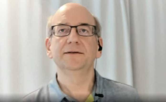 Screenshot of John Mueller considering how to answer a question about backlinks