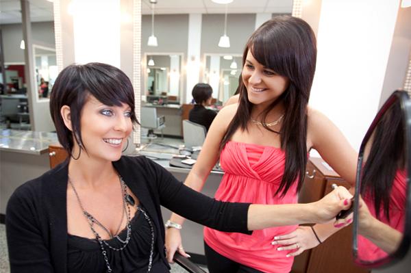Woman getting haircut