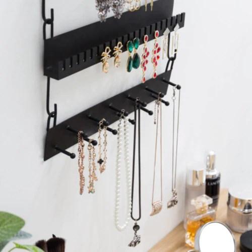 black metal wall mounted jewelry rack