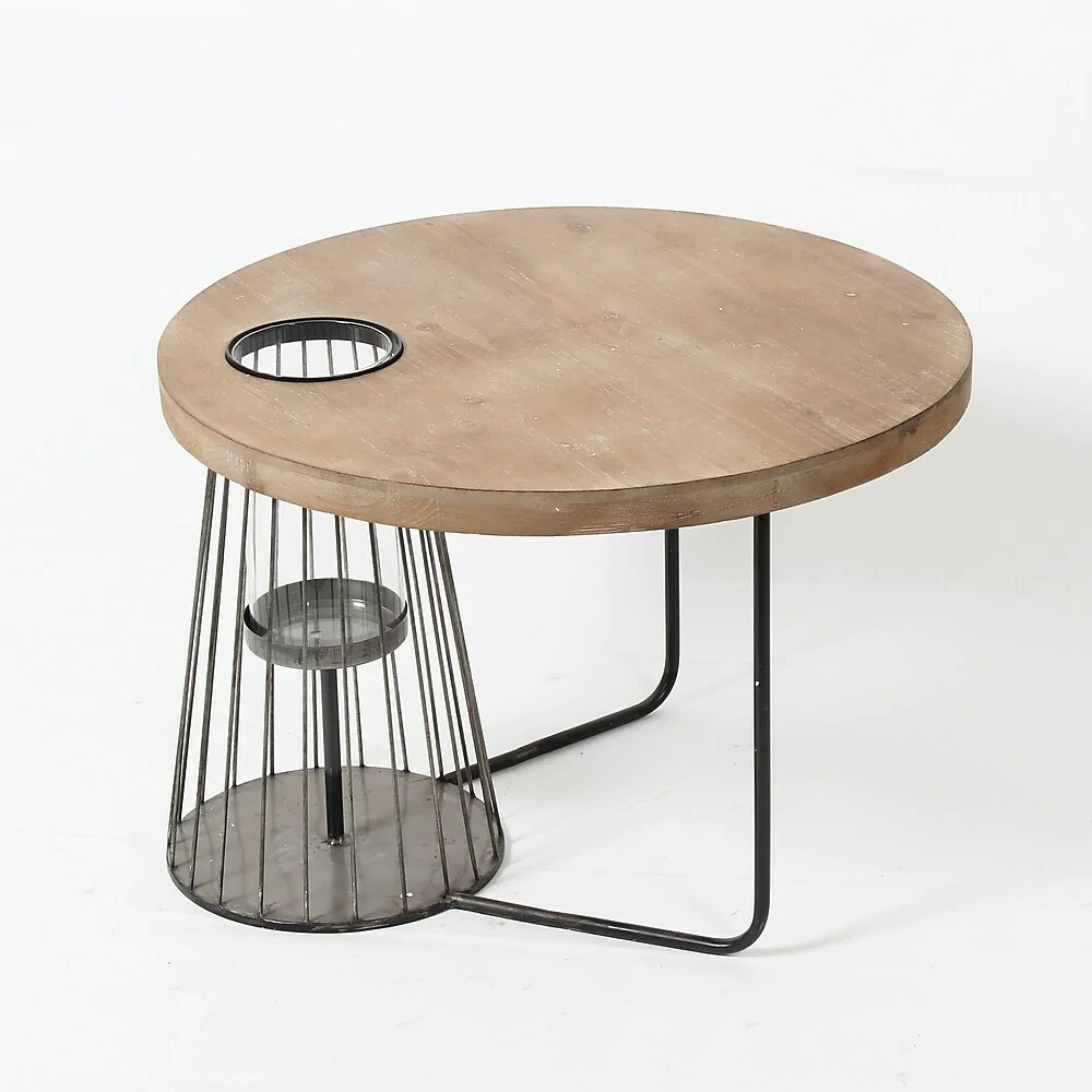 round side table with abstract metal legs and glass vase