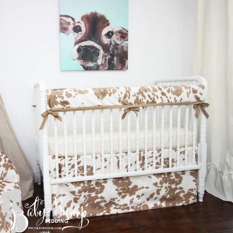 tan cowhide gender neutral crib bedding set