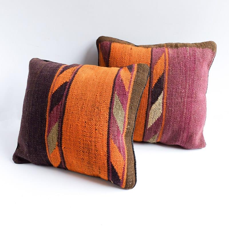 kilim pillow in blocks of orange aubergine and grey