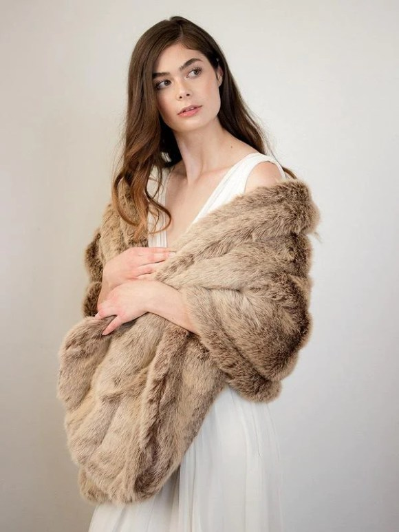 Courcheval faux fur mink shawl by Davie & Chiyo wrapped around bride's shoulders