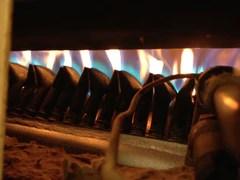 Gas burners underneath the roasting drum