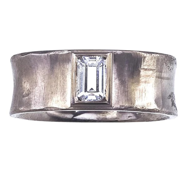 Modern Concave Ring With Emerald Cut Bezel Set Diamond