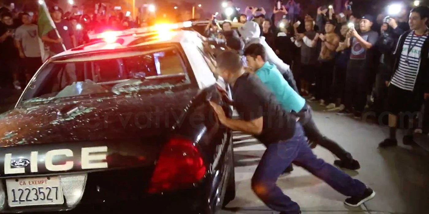https://i1.wp.com/cdn.shopify.com/s/files/1/0226/7001/articles/Hundreds-Of-Donald-Trump-Protesters-Surround-And-Destroy-Police-Car-At-Costa-Mesa_-California-Rally.jpg