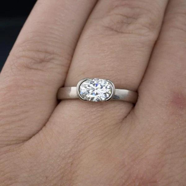 Oval Moissanite Half Bezel Solitaire Engagement Ring