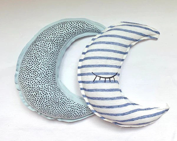 crescent moon shaped striped pillow