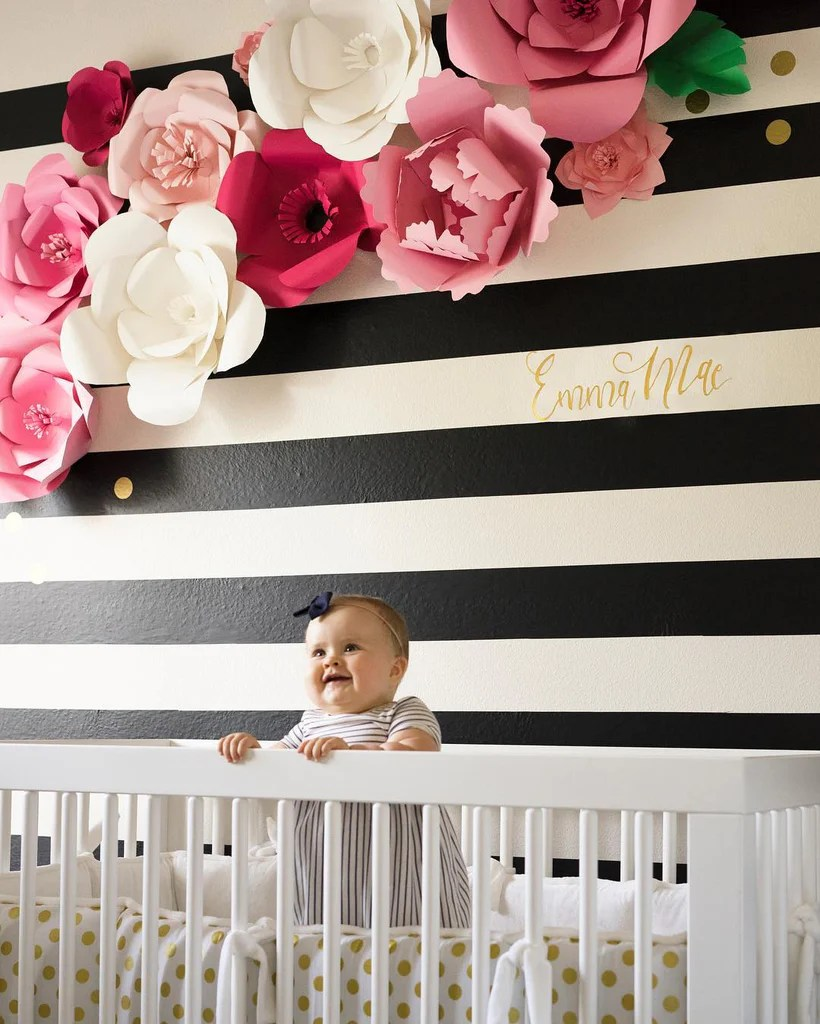 Bold black Easy Stripe wall decals by @wallsneedlove and paper flowers by Bloom Box