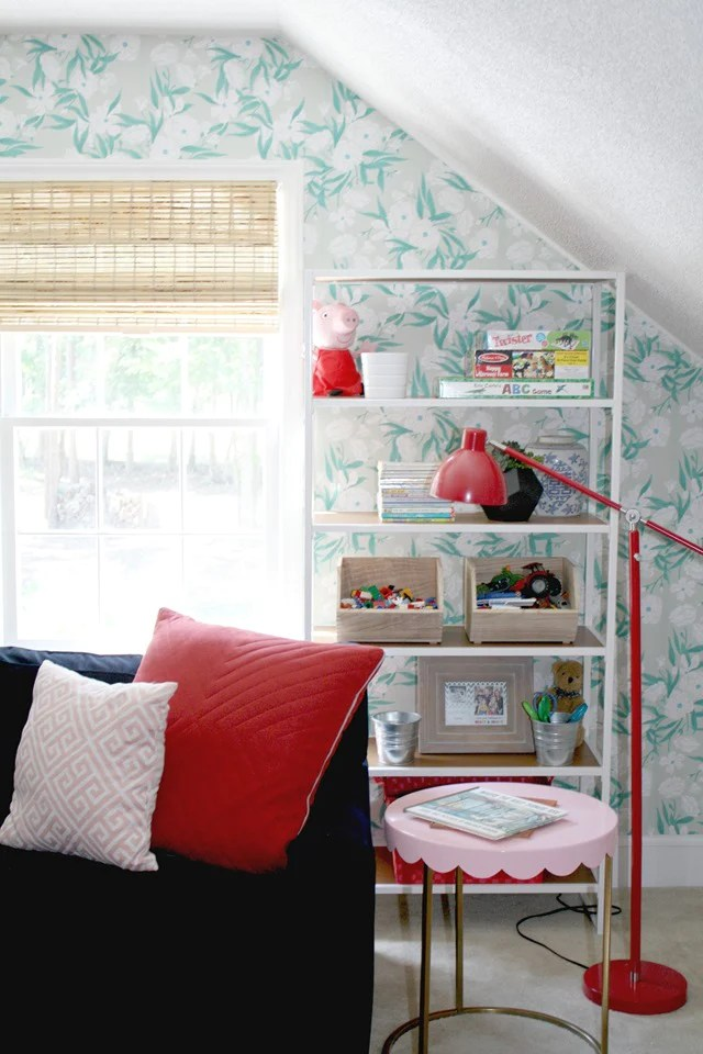 Emily A. Clark turned her kids' playroom into a chic, fun space using fun pops of color and removable wallpaper from @wallsneedlove.