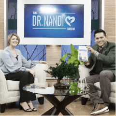 Dr. Myers sitting on the set of Dr. Nandi