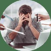 Man overwhelmed at desk