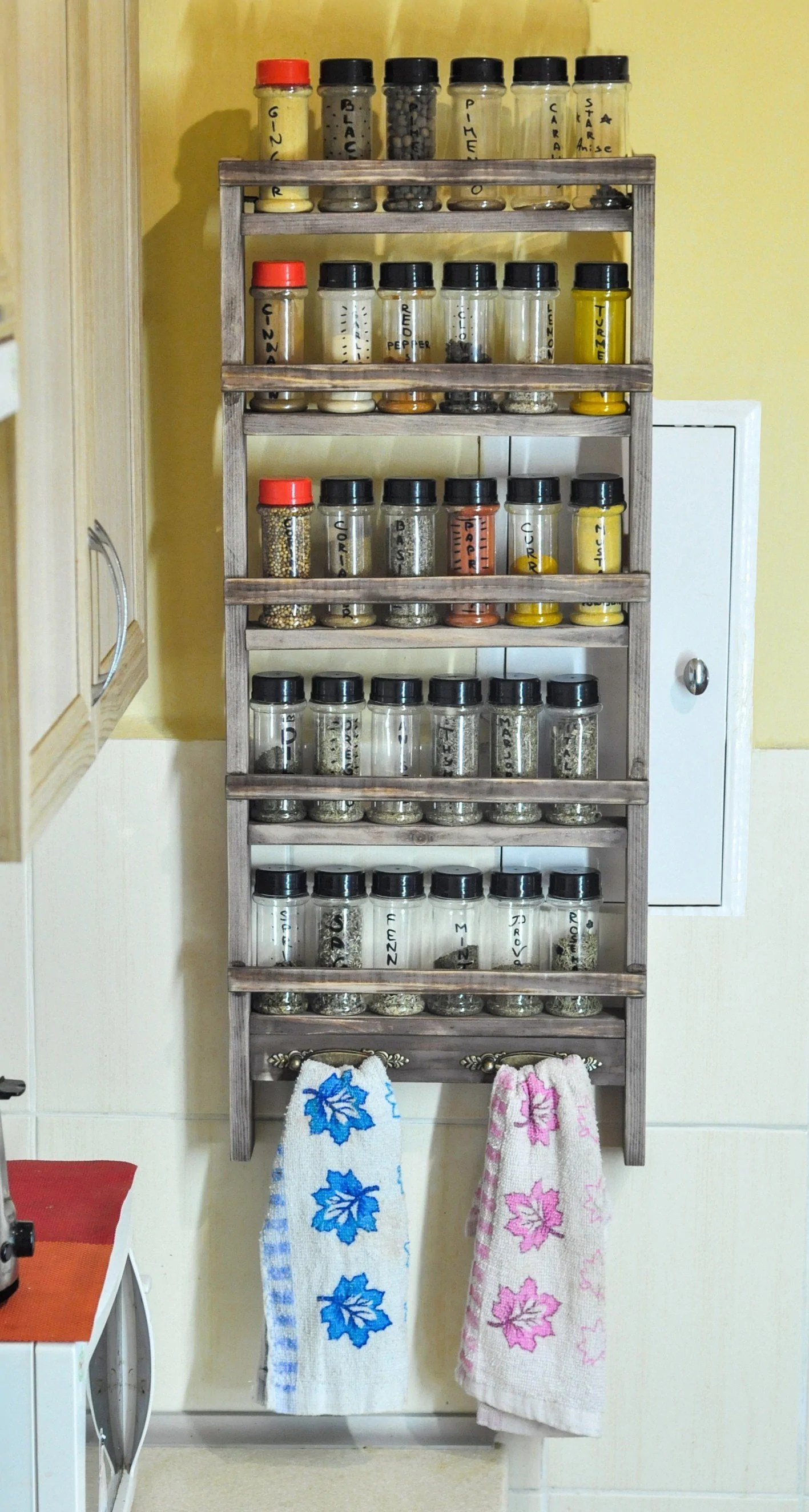 large farmhouse spice rack with towel holders