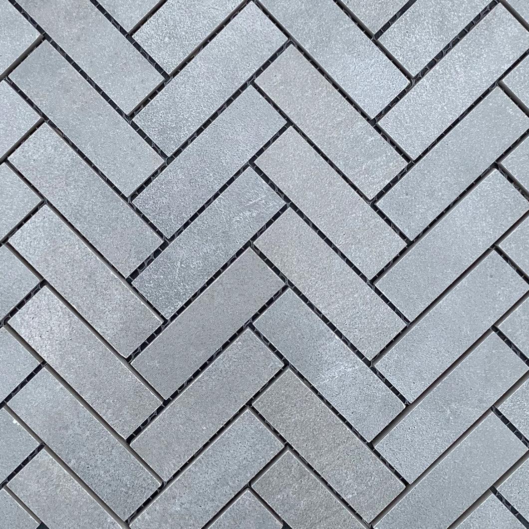 plenty rocks concrete herringbone mosaic tile