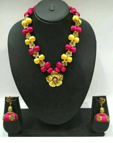 Pink And Yellow Silk Balls With Golden Floral Pendant Silk