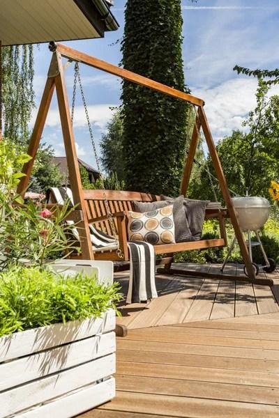 choosing between a porch swing vs a glider
