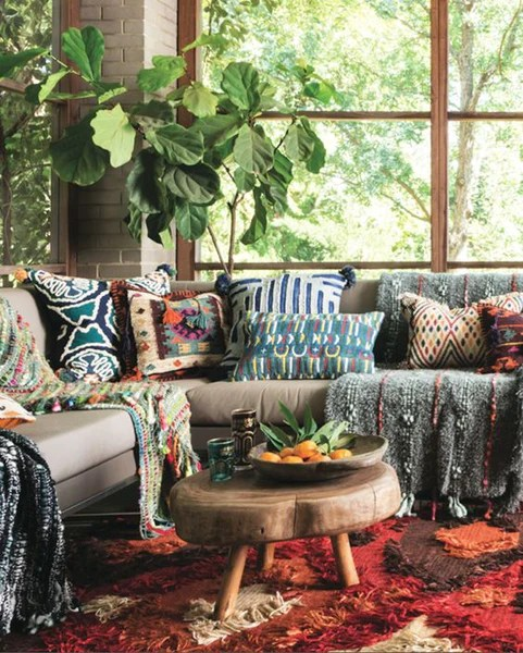 Bohemian textiles on a corner sofa with fig leave plant