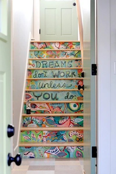 painted staircase saying the words dreams don't work unless you do