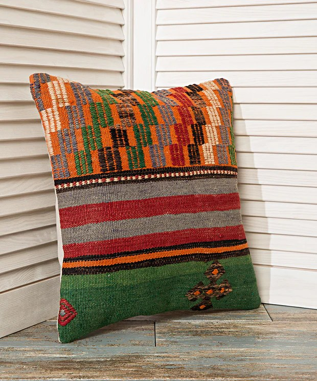 green and orange kilim pillow