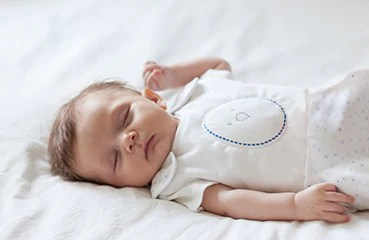 baby sleeping in nested bean sleep sack