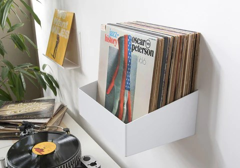 a cool wall mounted record shelf record